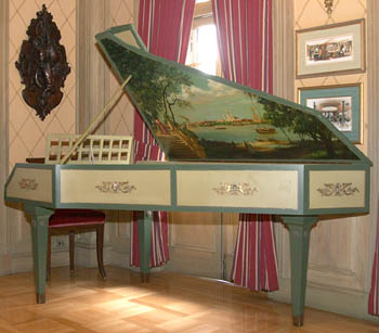 The mural on this antique harpsichord was painted by Imagineers.