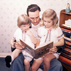 Walt the family man reads to his daughters.
